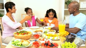 stock-footage-young-ethnic-family-enjoying-a-healthy-lunch-together-at-home