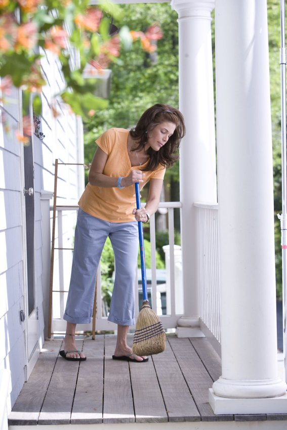 17107-a-woman-sweeping-her-front-porch-pv